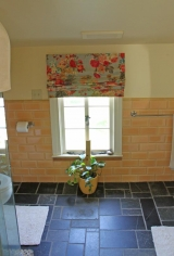 <h5>Window Valance</h5><p>The floral shades in this custom valance pair perfectly with the cantaloupe hue found in the tile work.</p>