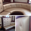 <h5>Custom Rounded Tufted Booth</h5>
