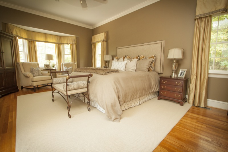 Wendy's master bedroom was so inviting with rich gold draperies and beautiful custom bedding.